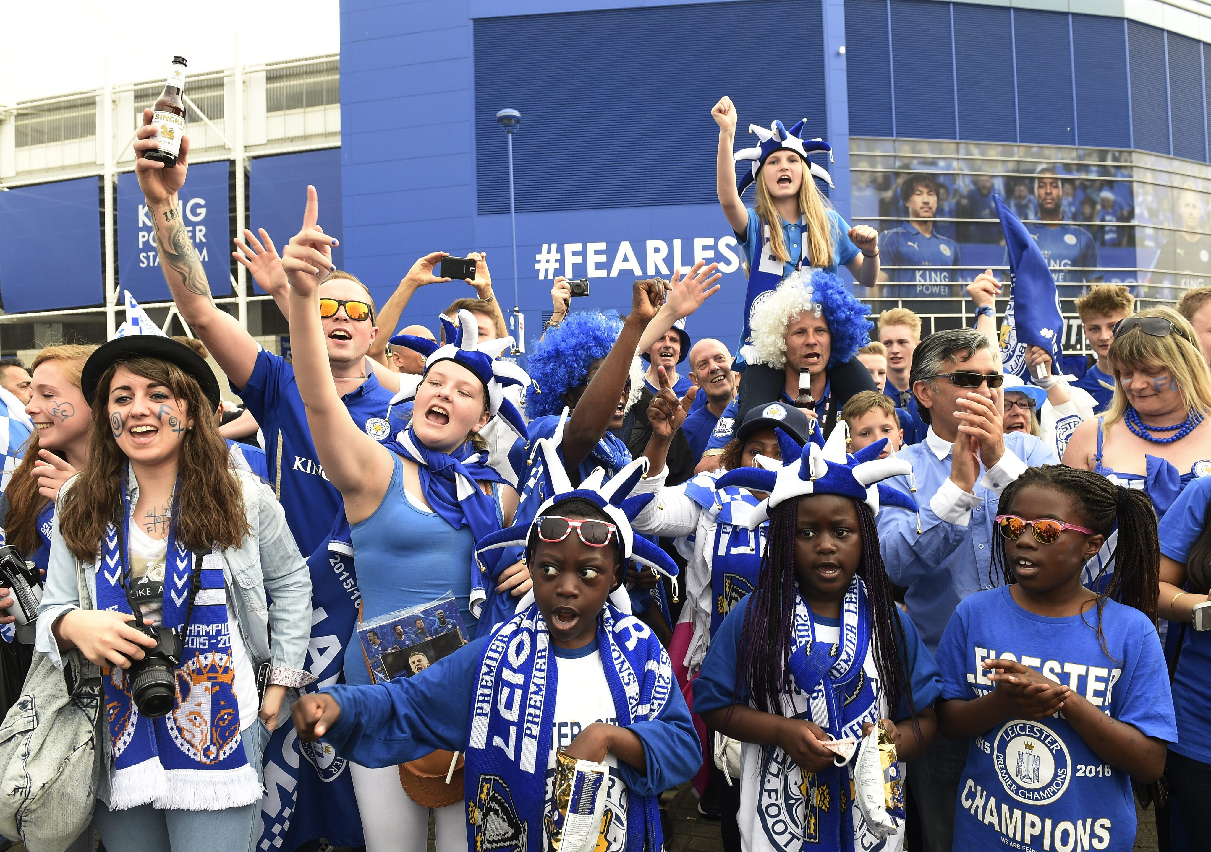 Leicester supporters celebrate winning the title