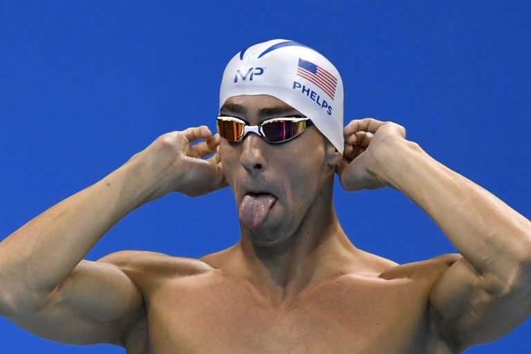 USA's Michael Phelps prepares to compete in a Men's 200m Butterfly heat during the swimming event at the Rio 2016 Olympic Games at the Olympic Aquatics Stadium in Rio de Janeiro on August 8, 2016. / AFP PHOTO / CHRISTOPHE SIMON