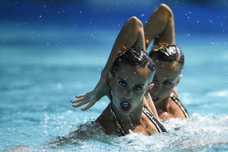 Nado sincronizado en los Juegos Olímpicos. Pulzo.com