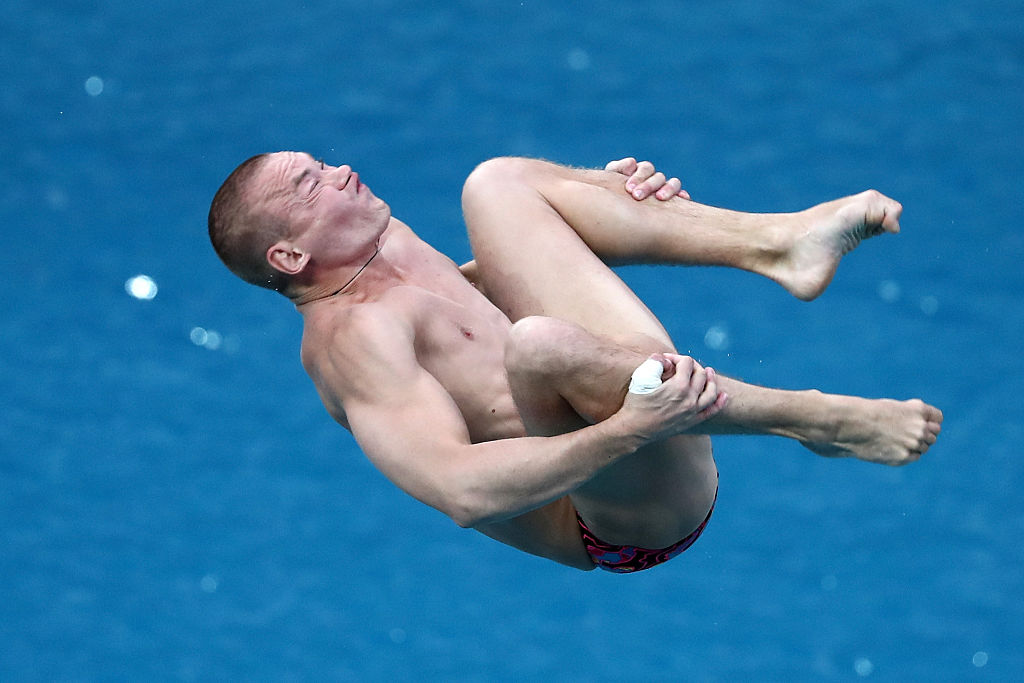 RIO DE JANEIRO, BRAZIL - AUGUST 15: Evgenii Kuznetsov of Russia competes in the Men's Diving 3m Springboard Preliminary Round on Day 10 of the Rio 2016 Olympic Games at Maria Lenk Aquatics Centre on August 15, 2016 in Rio de Janeiro, Brazil. (Photo by Al Bello/Getty Images)