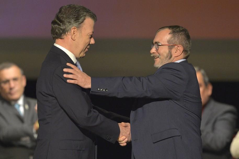 Presidente Juan Manuel Santos y 'Timochenko'