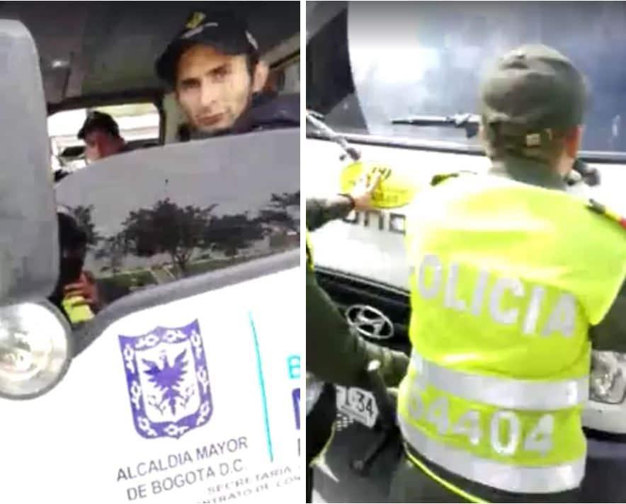 Conductor de la grúa y auxiliares de la Policía impidiendo el paso del vehículo