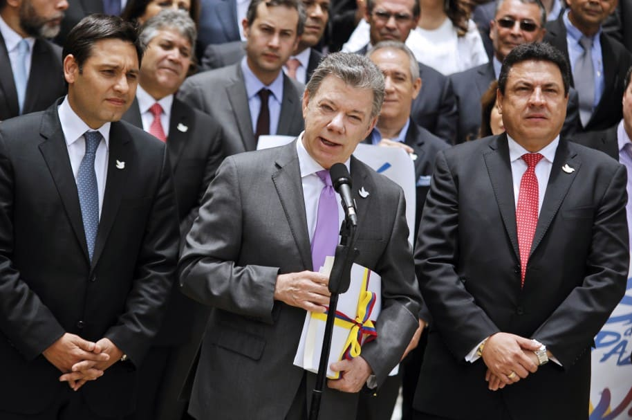 Mauricio Lizcano (izq.) junto al presidente Juan Manuel Santos