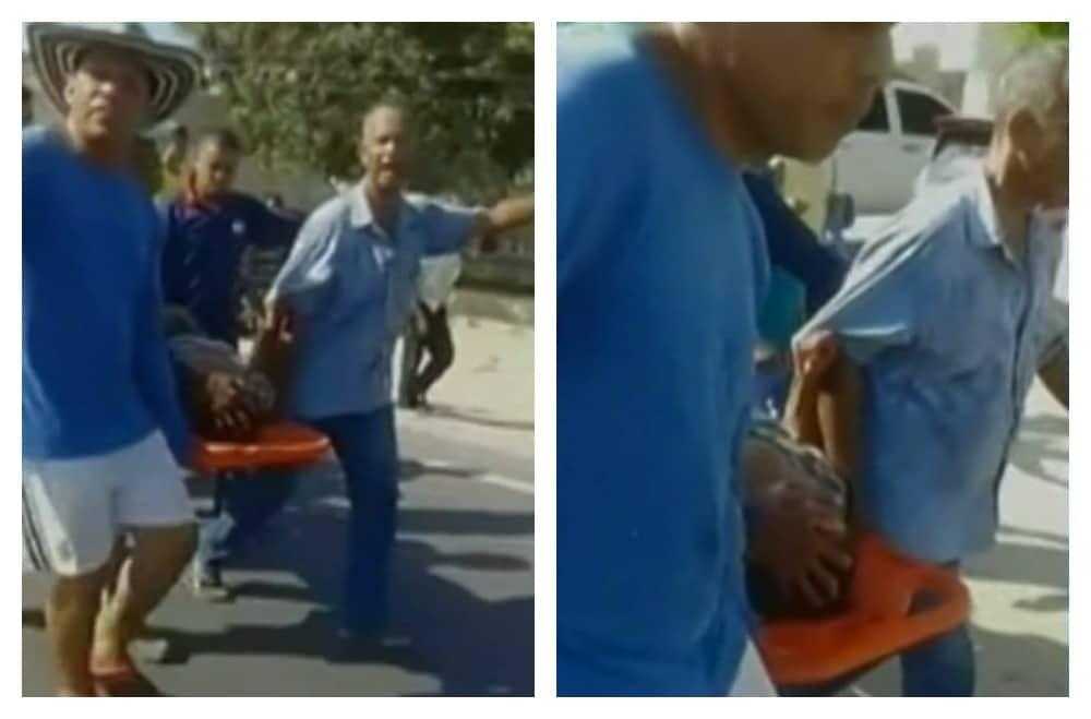 Habitantes de Palmar de Varela trasladan a anciana atropellada en una camilla. Pulzo.com