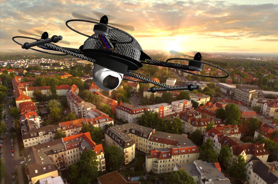 Dron volando sobre casas. Pulzo.com