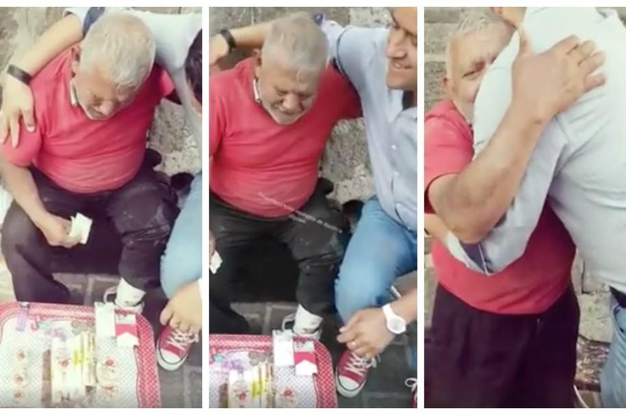 Hombre compra toda la mercancía de veterano vendedor ambulante y luego lo abraza. Pulzo.com