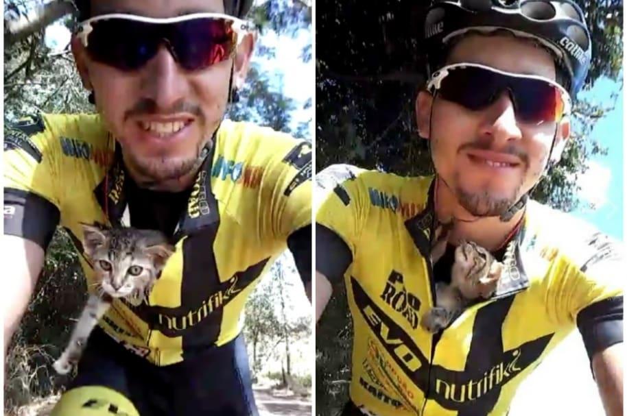 Ciclista recoge a gato abandonado.