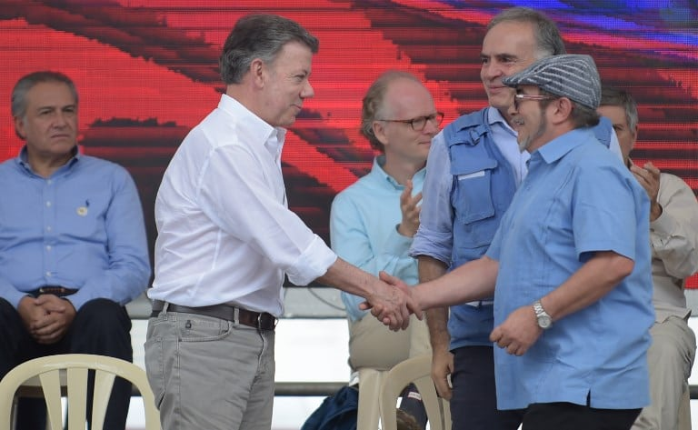 Juan Manuel Santos y 'Timochenko'