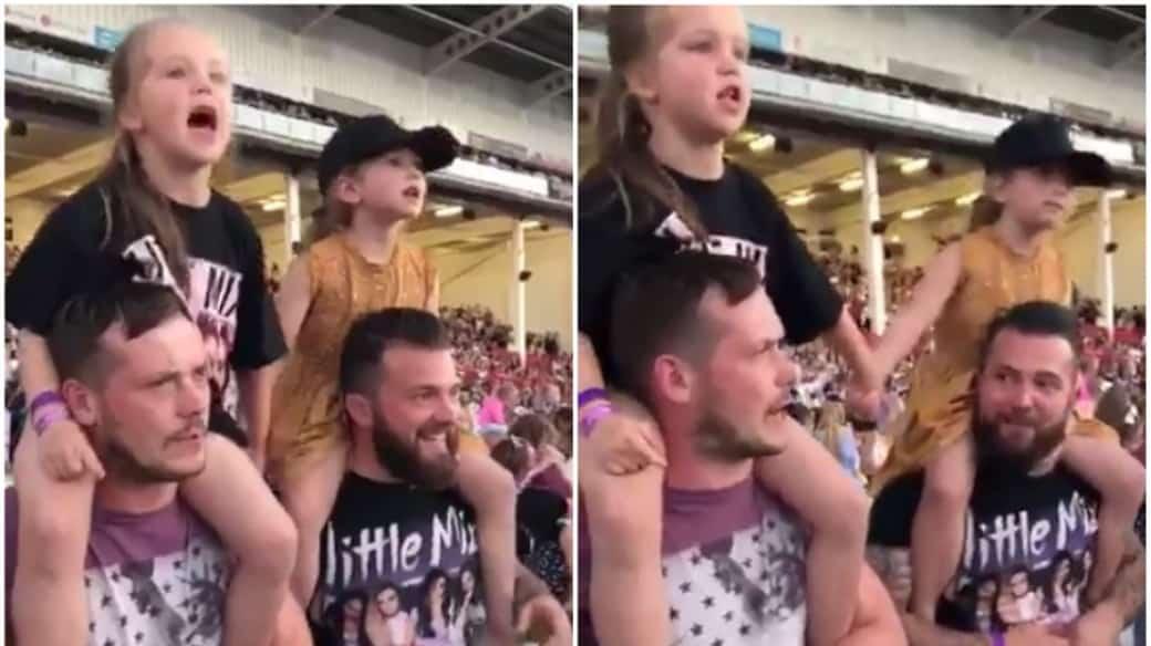Niñas y padres en concierto.