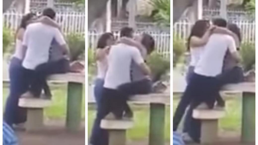 Hombre besa a dos mujeres en parque de El Salvador. Pulzo.com