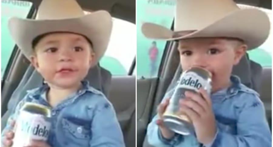 Niño toma cerveza.