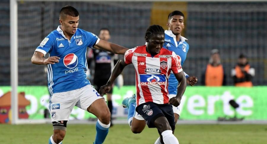 Yimmi Chará con Junior, en un partido contra Millonarios