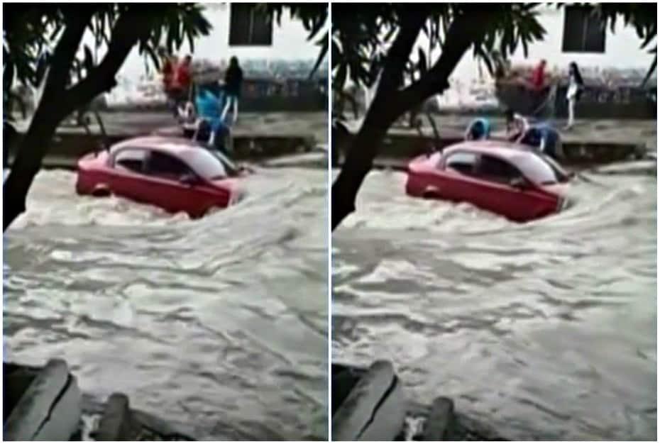 Carro atascado en arroyo en Barranquilla.