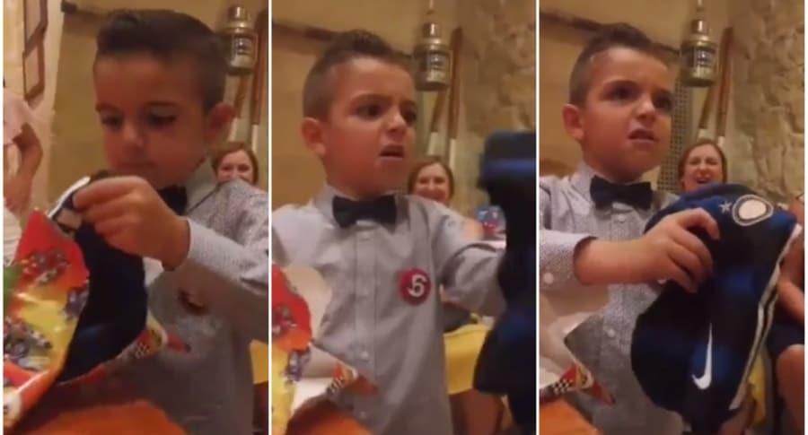 Niño recibe camiseta del Inter.