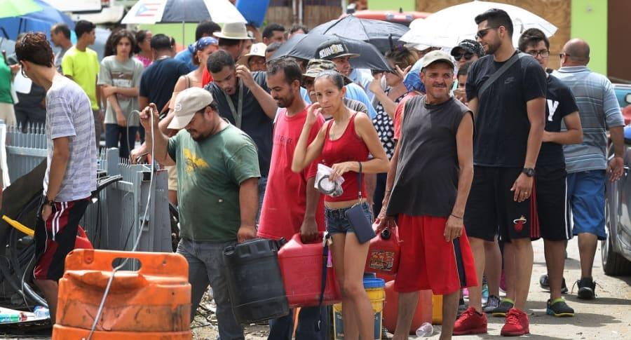 Puertorriqueños afectados por el huracán María