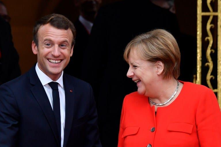 Emmanuel Macron y Angela Merkel. Pulzo.