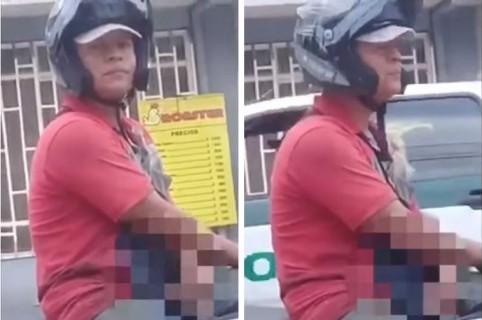 Motociclista se masturba frente a mujer