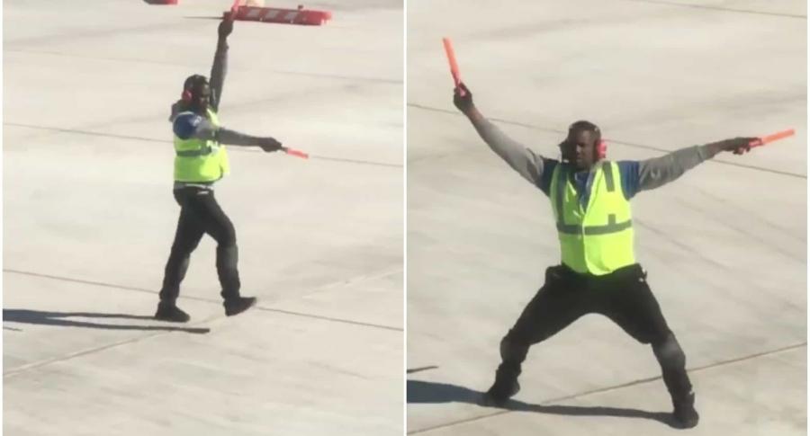 Empleado de aeropuerto bailando en la pista. Pulzo.