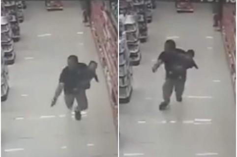 Policía dispara con bebé en sus brazos.
