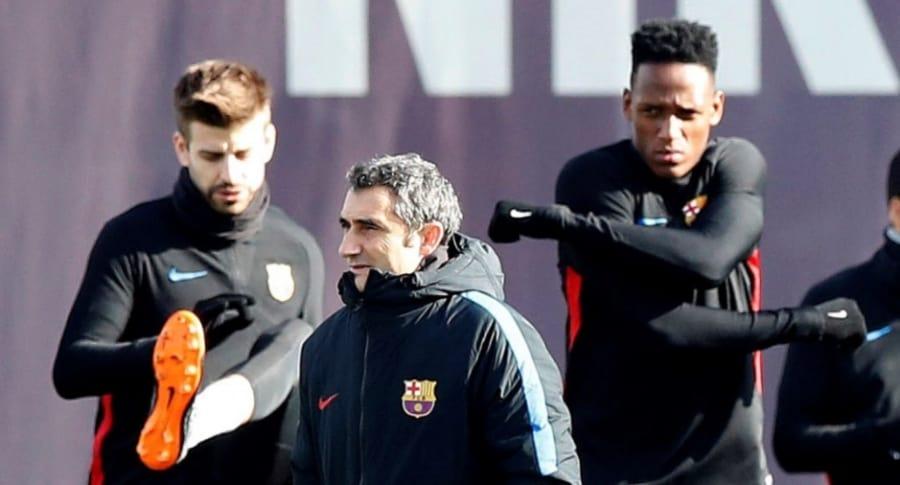 Gerard Piqué, Yerry Mina y Ernesto Valverde