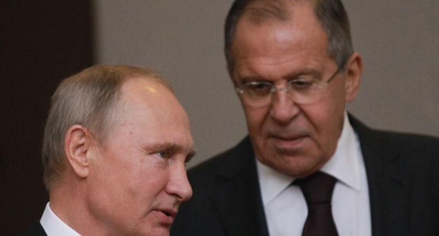 Vladimir Putin y Sergey Lavrov