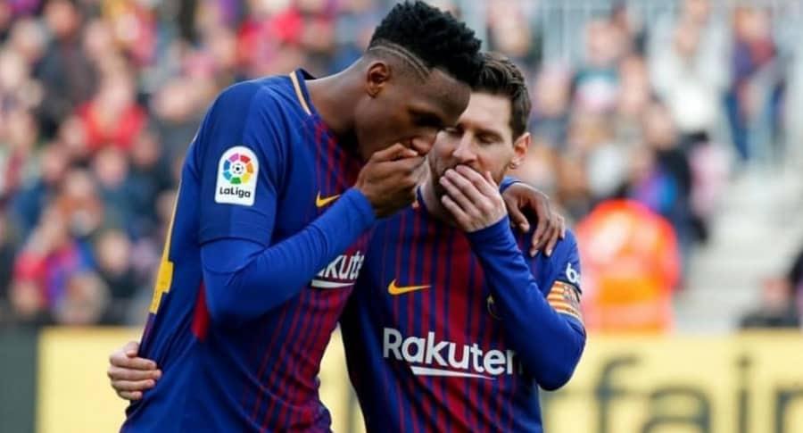Yerry Mina y Lionel Messi