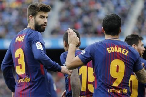 Gerard Pique y Luis Suárez