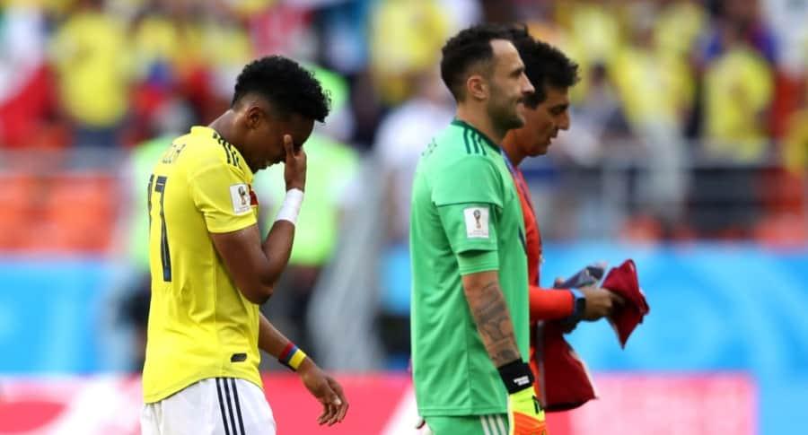 Johan Mojica y David Ospina después de la derrota contra Japón