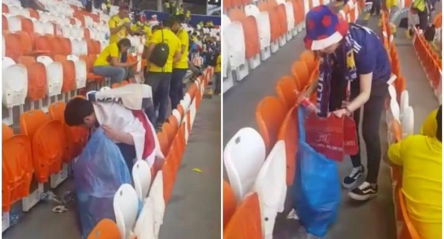 Hinchas japoneses recogen basura tras partido contra Colombia, en Mundial de Rusia.