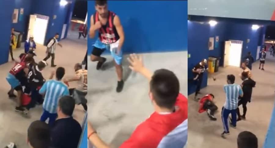 Hinchas argentinos golpeando a croatas