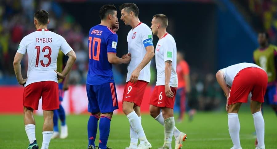 James y Lewandowski en el partido entre Colombia y Polonia