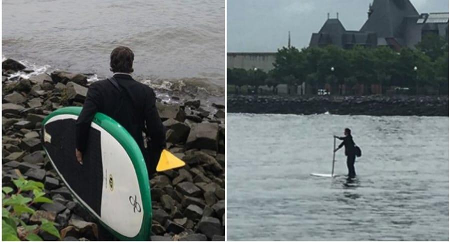 Hombre cruza río en tabla de surf.