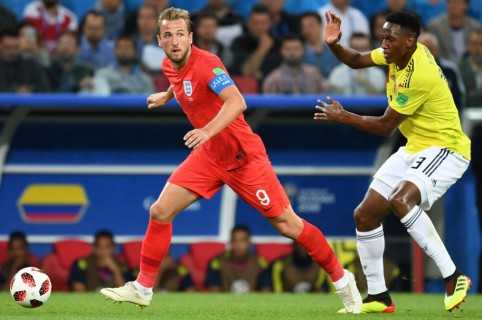 Yerry Mina y Harry Kane