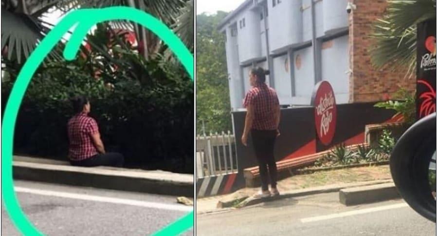 Mujer que espera en entrada de motel