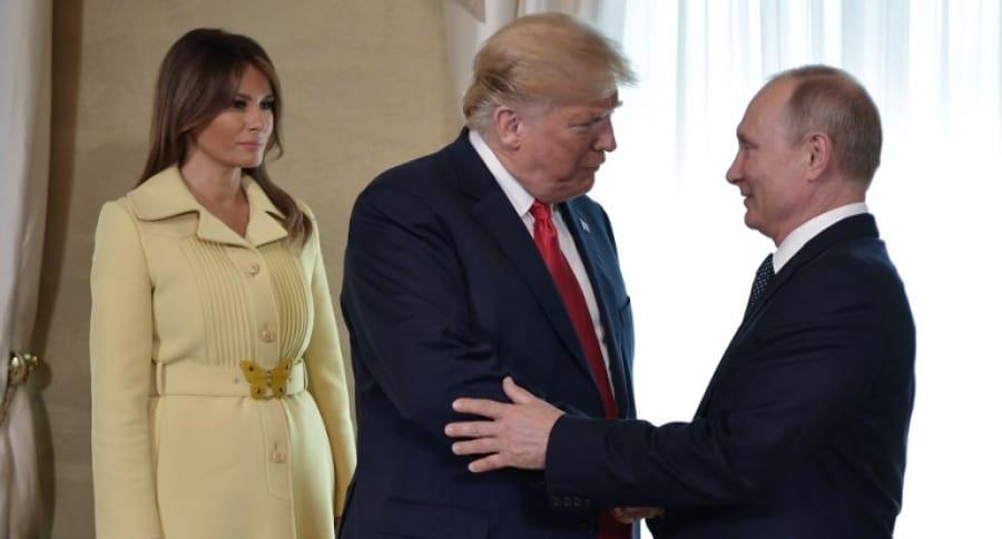 Melania y Donald Trump con Vladimir Putin