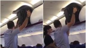 Hombre no puede poner su maleta en portaequipajes,