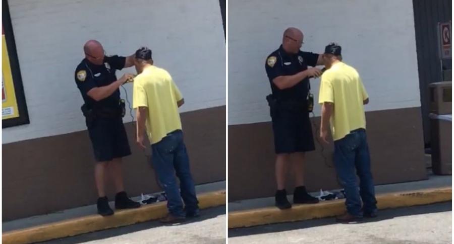 Policía afeita a indigente.