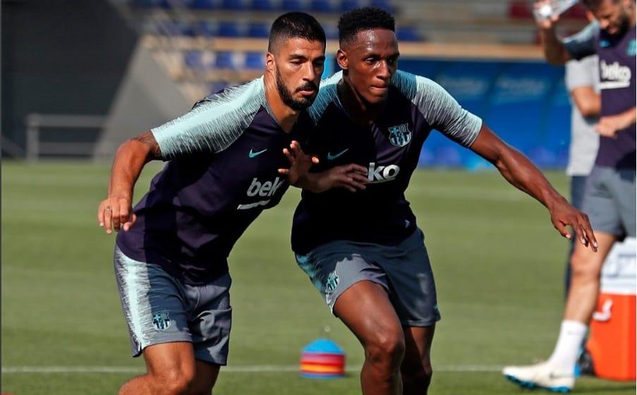 Yerry Mina con Luis Suárez