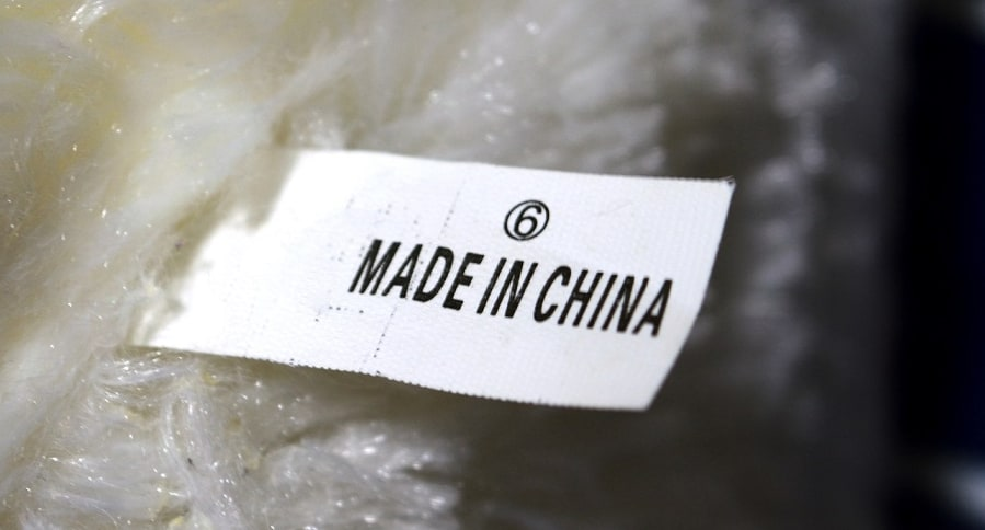 """""""Made in China"""" tagged between doll's fur"""