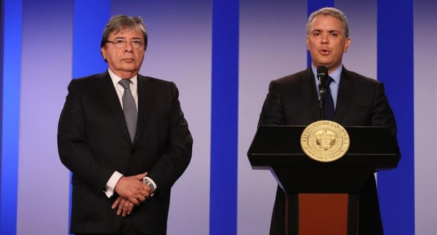 Iván Duque y Carlos Homes Trujillo