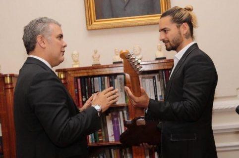 Iván Duque y Maluma