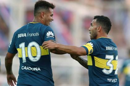 Edwin Cardona y Carlos Tévez, futbolistas.