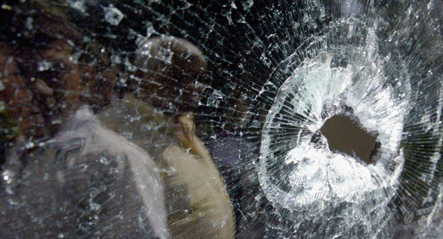 Hueco de bala en vidrio