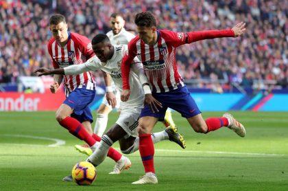 Santiago Arias en el derbi de Madrid