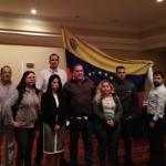 Grupo de personas dentro de la embajada de Venezuela en Costa Rica.