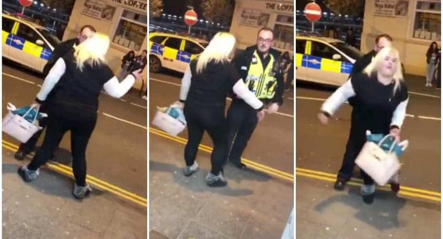 Borracha le baila a un policía.