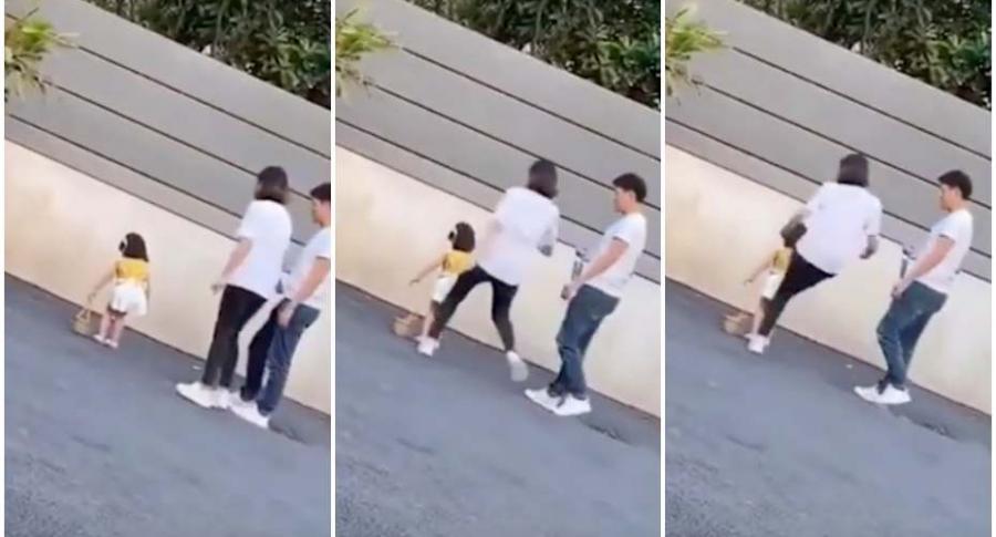 Mujer patea a niña.