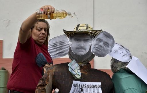 Muñeco de Trump y Cabello
