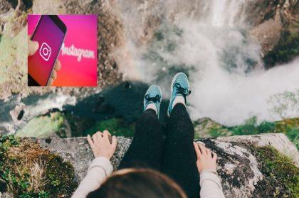 Mujer sobre una roca, al borde de río