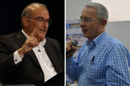 Humberto de la Calle y Álvaro Uribe